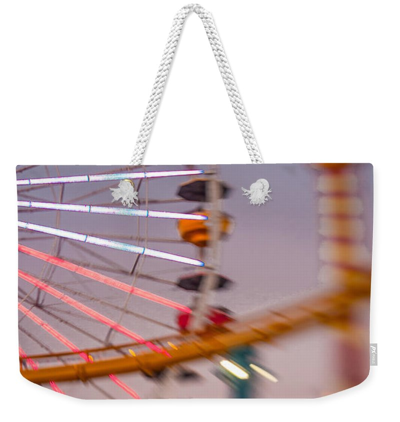 Carousel Weekender Tote Bag featuring the photograph Santa Monica Pier Ferris Wheel And Roller Coaster At Dusk by Scott Campbell