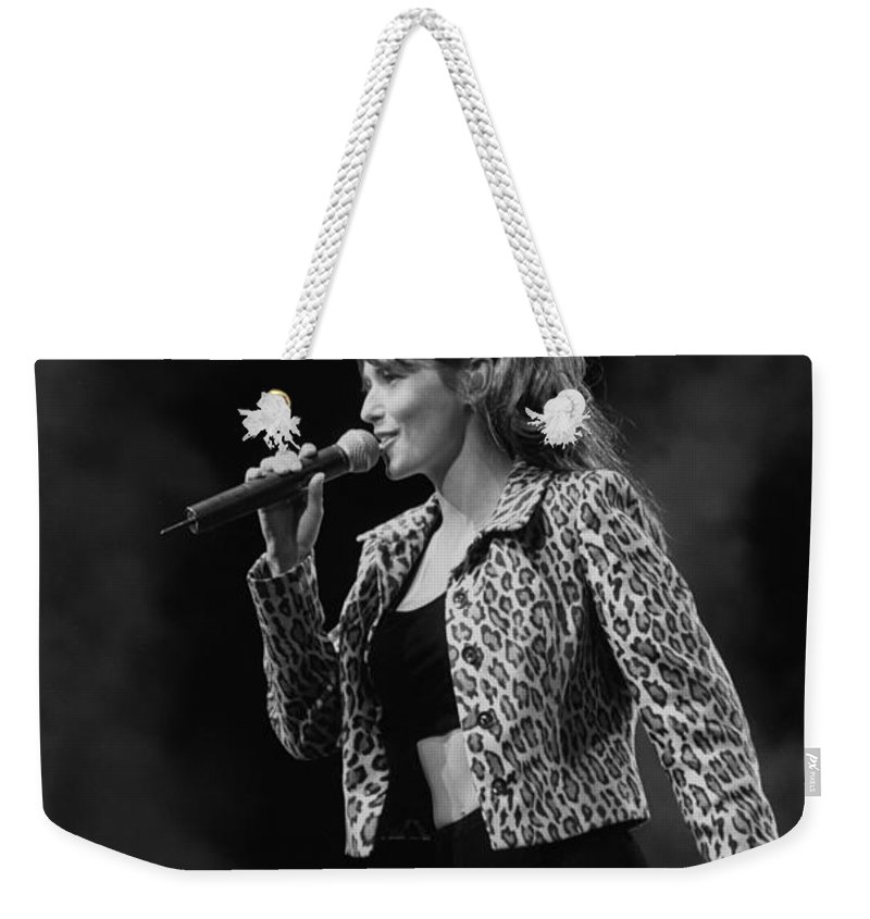 Canadian Singer Weekender Tote Bag featuring the photograph Singer Shania Twain by Concert Photos