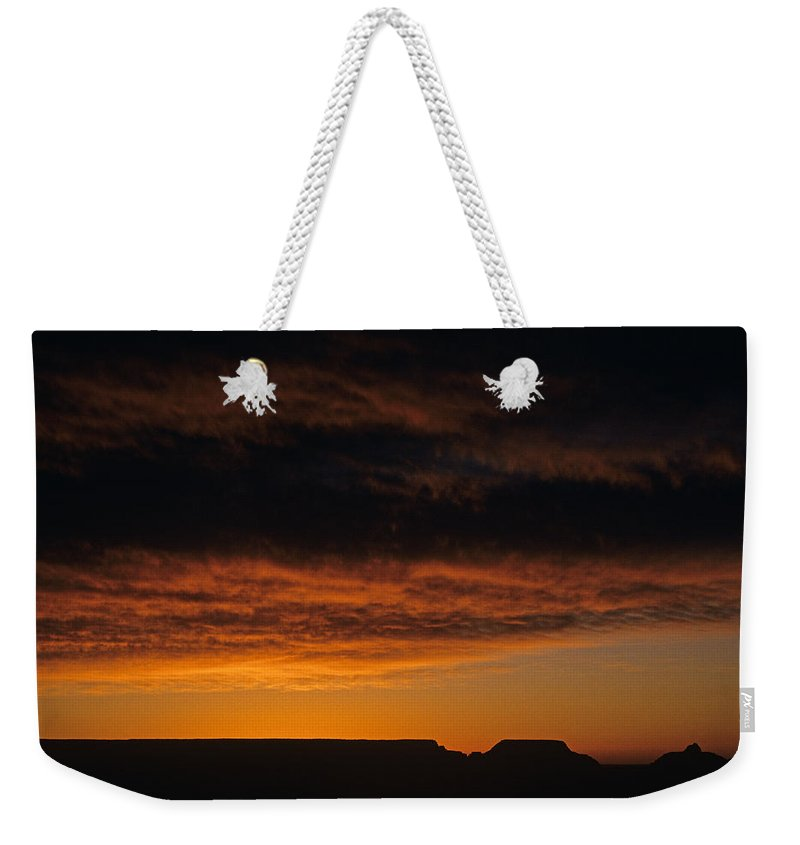 Grand Canyon National Park Weekender Tote Bag featuring the photograph South Rim Grand Canyon Dramatic Clouds Sunset With Silhouetted R by Jim Corwin