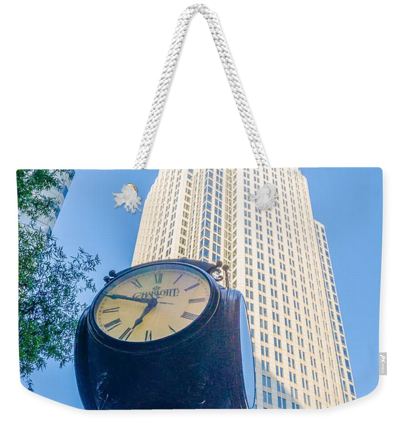Banking Weekender Tote Bag featuring the photograph Standing By The Clock On City Intersection At Charlotte Downtown by Alex Grichenko