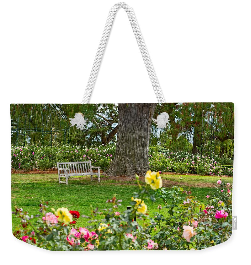 Rose Garden Weekender Tote Bag featuring the photograph Stop And Smell The Roses by Jamie Pham
