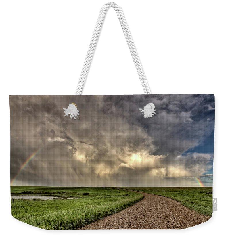 Nature Weekender Tote Bag featuring the digital art Storm Clouds Prairie Sky Saskatchewan by Mark Duffy
