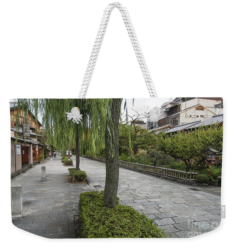 Architecture Weekender Tote Bag featuring the photograph Street In Kyoto Japan by Jacek Malipan