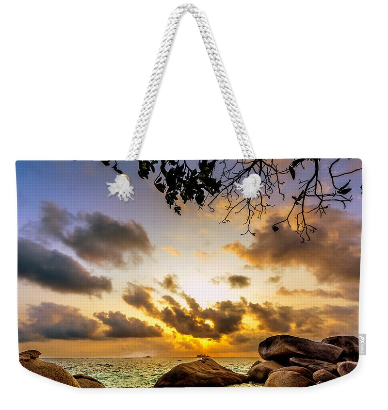 Beach Weekender Tote Bag featuring the photograph Sun Sand Sea And Rocks by Jijo George