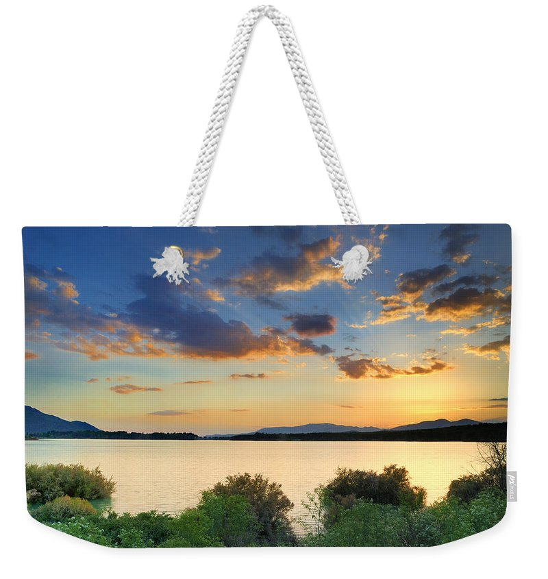 Sunrays Weekender Tote Bag featuring the photograph Sunrays At The Lake by Guido Montanes Castillo