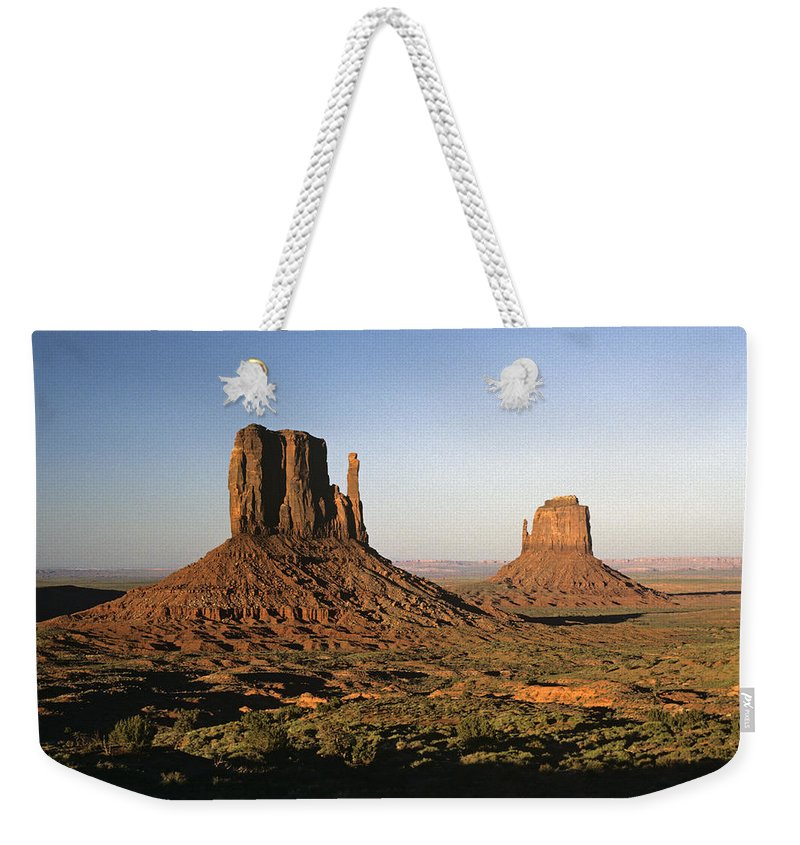 Arizona Weekender Tote Bag featuring the photograph Sunset Light With Mittens And Desert In Monument Valley Arizona by Jim Corwin