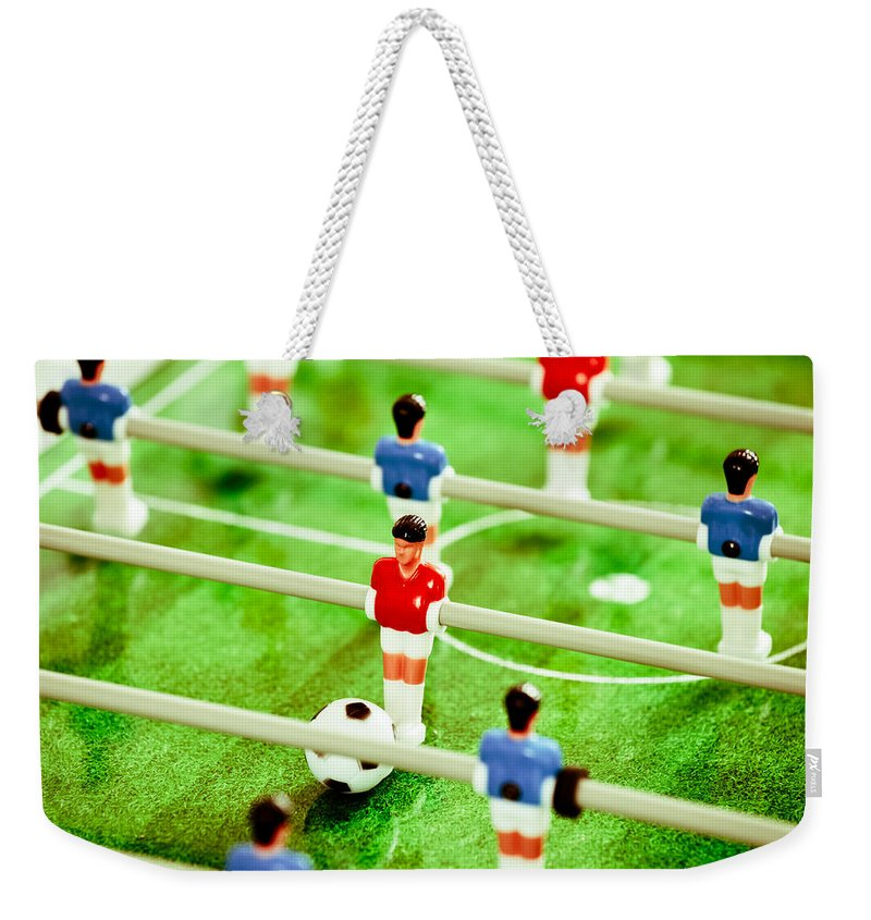 Action Weekender Tote Bag featuring the photograph Table Football by Tom Gowanlock
