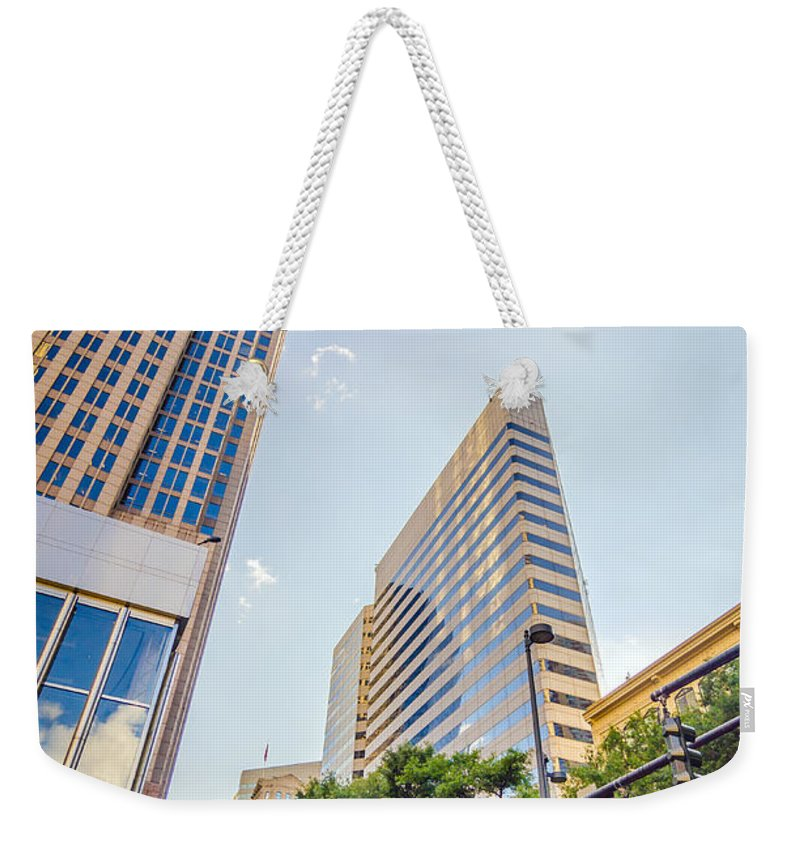 America Weekender Tote Bag featuring the photograph Tall Highrise Buildings In Uptown Charlotte Near Blumenthal Perf by Alex Grichenko
