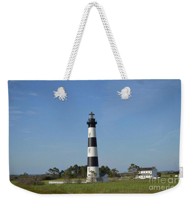 The Bodie Island Light House Weekender Tote Bag featuring the photograph The Bodie Island Light House by Robert Loe