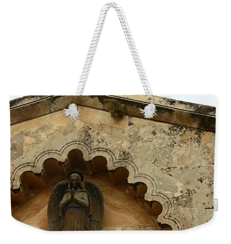 Prayer Weekender Tote Bag featuring the photograph The Prayer by Munir Alawi
