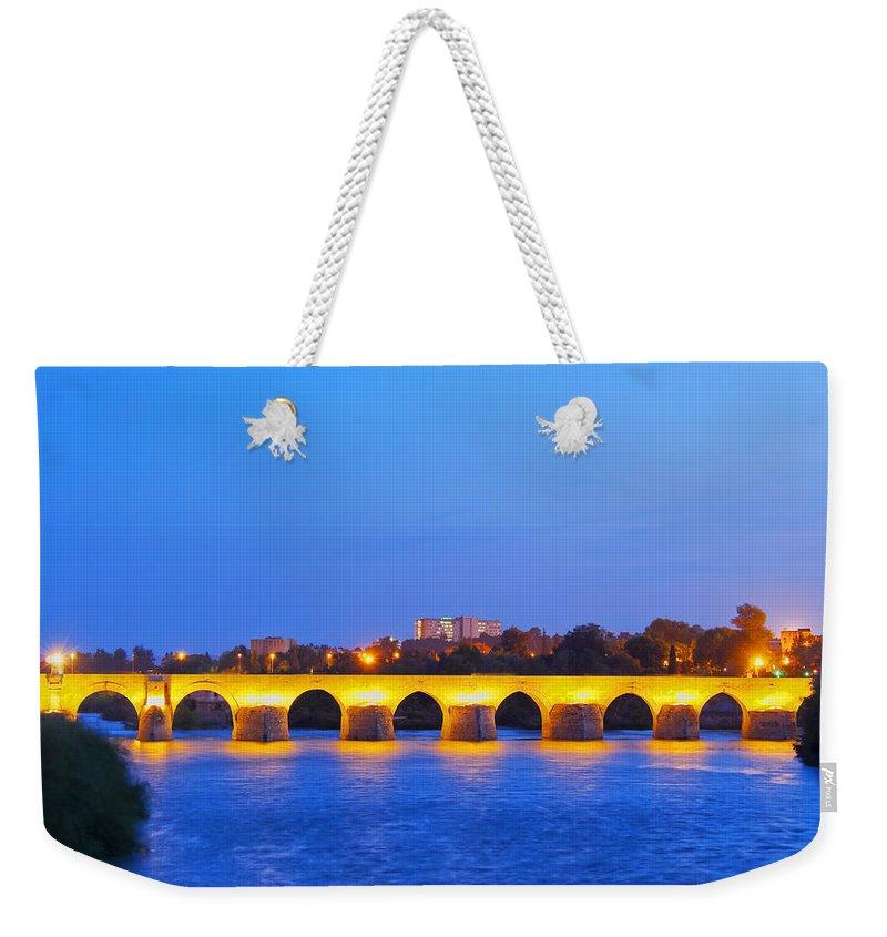 Horizontal Weekender Tote Bag featuring the photograph The Roman Bridge In Cordoba by Karol Kozlowski