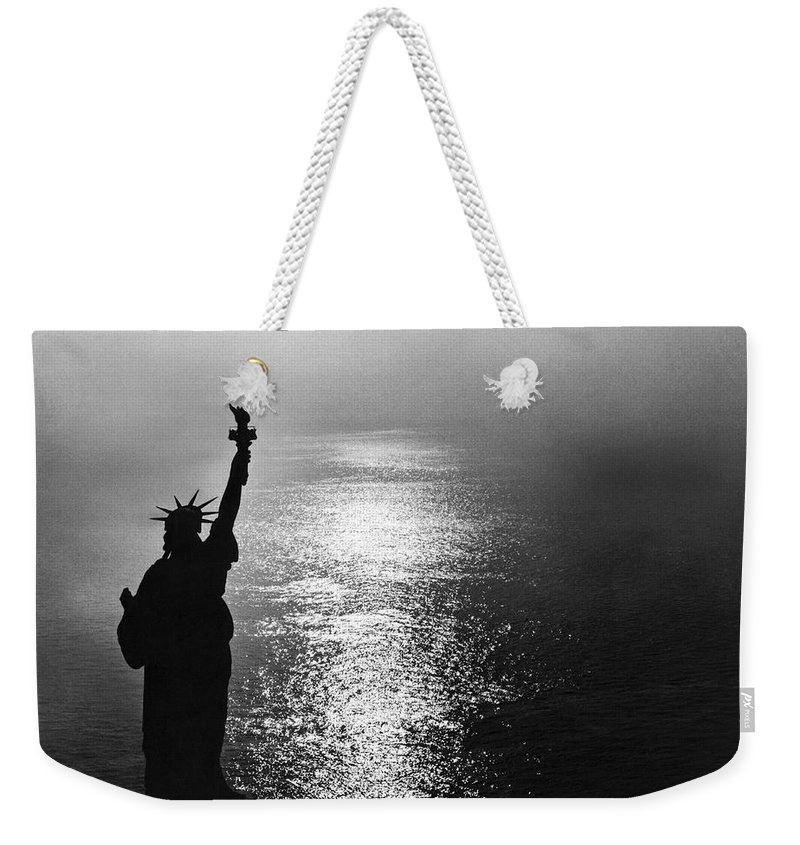 1950's Weekender Tote Bag featuring the photograph The Statue Of Liberty by Underwood Archives