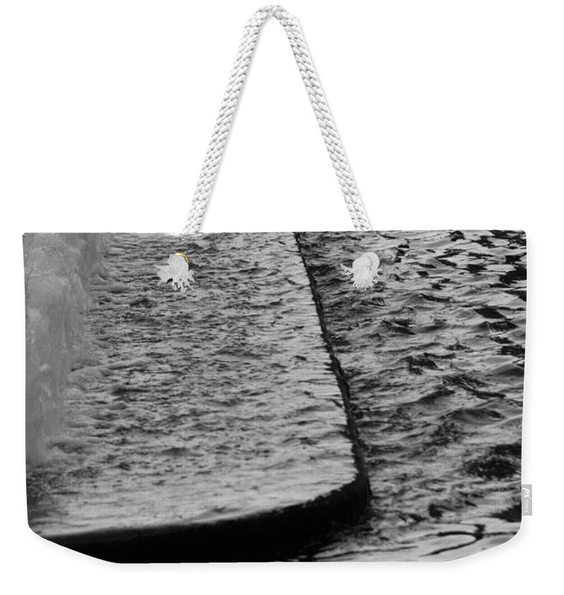Scenic Weekender Tote Bag featuring the photograph The Water Fountain In Black And White by Rob Hans