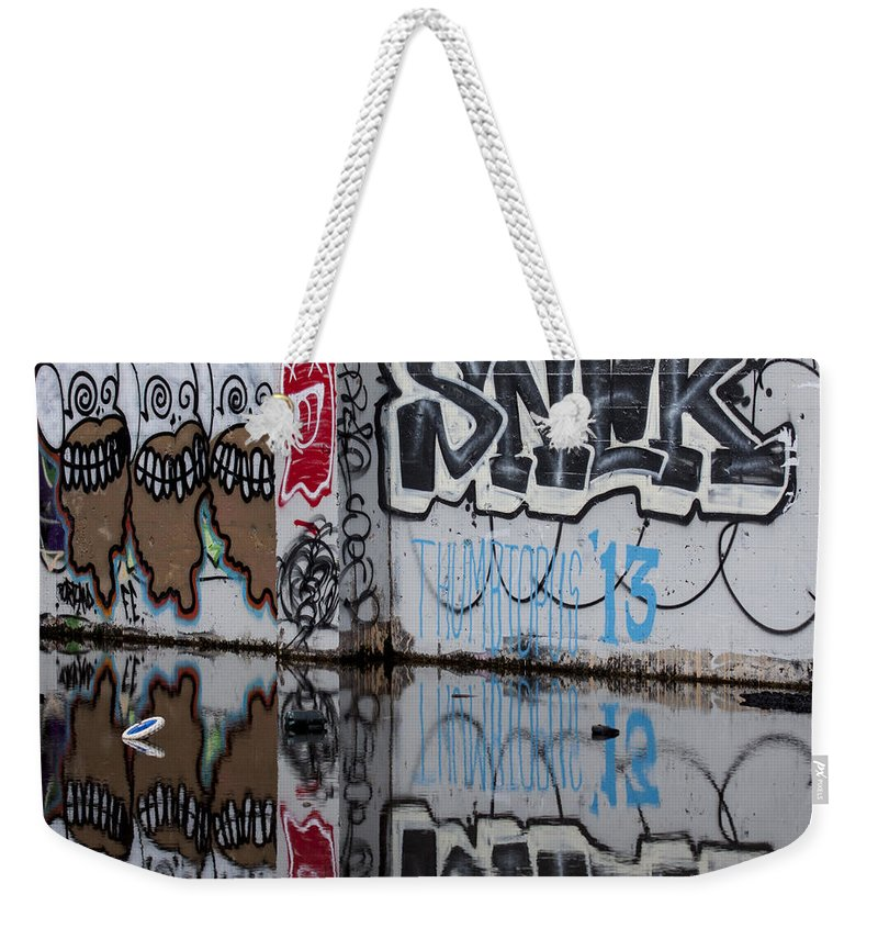 Graffiti Weekender Tote Bag featuring the photograph Three Skulls Graffiti by Carol Leigh