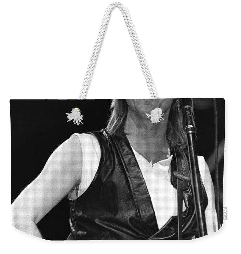 Singer Weekender Tote Bag featuring the photograph Tom Petty And The Heartbreakers by Concert Photos