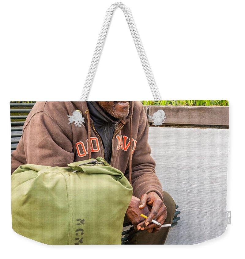 Nola Weekender Tote Bag featuring the photograph Travelin' Man by Steve Harrington