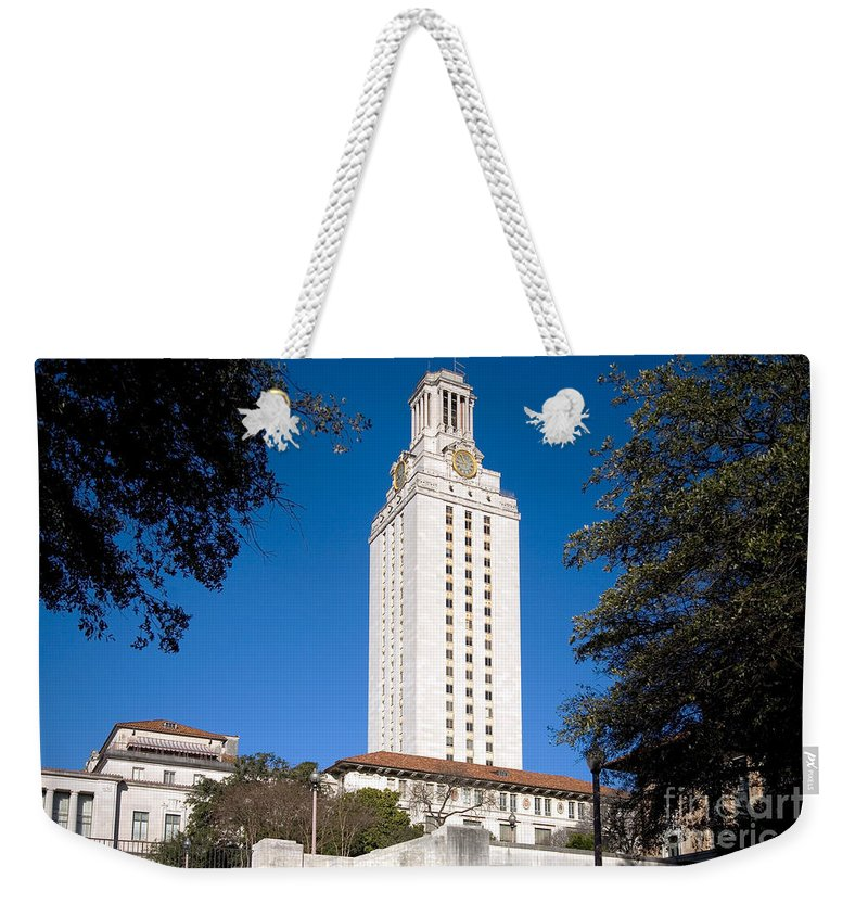 Austin Weekender Tote Bag featuring the photograph University Of Texas At Austin by Bill Cobb