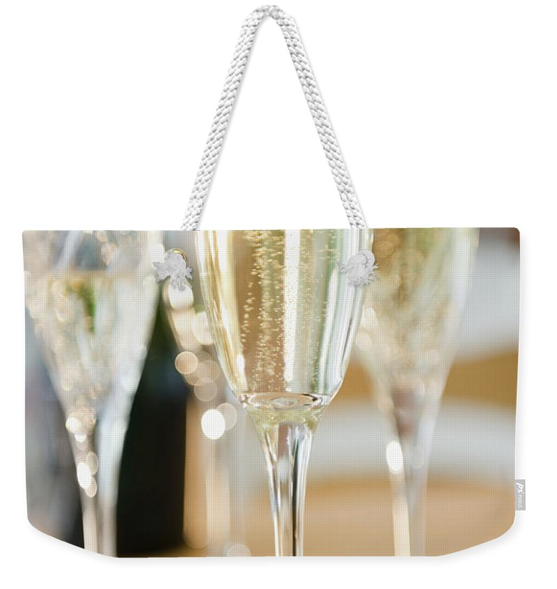 Celebration Weekender Tote Bag featuring the photograph Usa, New Jersey, Jersey City, Champagne by Jamie Grill