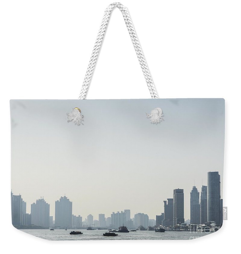 Architecture Weekender Tote Bag featuring the photograph View Of Shanghai River In China by Jacek Malipan