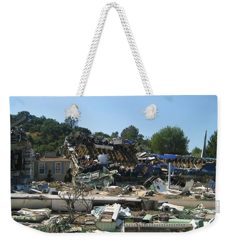 War Of The Worlds Weekender Tote Bag featuring the photograph War Of The Worlds - Universal Studios by Dany Lison