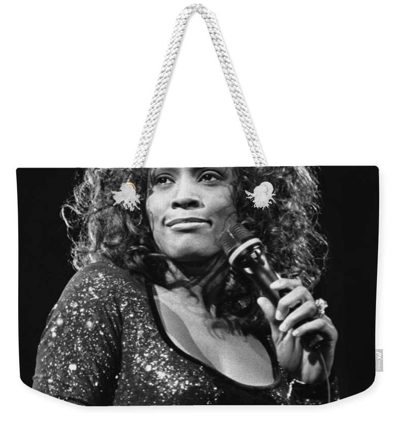 Singer Weekender Tote Bag featuring the photograph Whitney Houston by Concert Photos