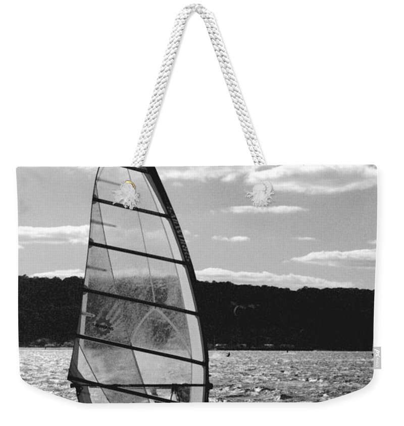 Sandy Weekender Tote Bag featuring the photograph Wind Surfer Bw by Pablo Rosales