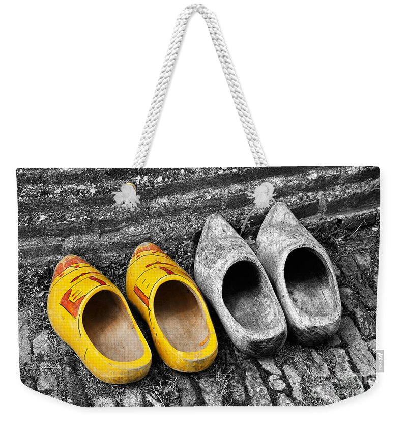 Wooden Weekender Tote Bag featuring the photograph Wooden Shoes by Louise Heusinkveld