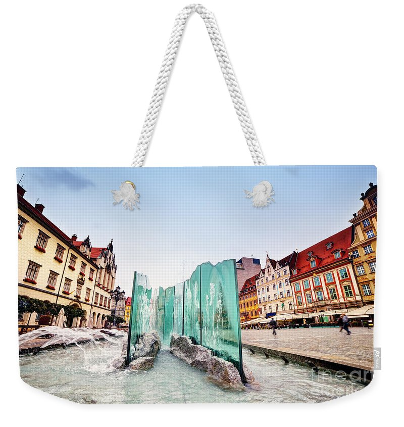 Wroclaw Weekender Tote Bag featuring the photograph Wroclaw Poland The Market Square With The Famous Fountain by Michal Bednarek