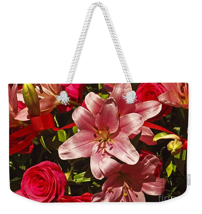 America Weekender Tote Bag featuring the photograph Rose Parade by Howard Stapleton