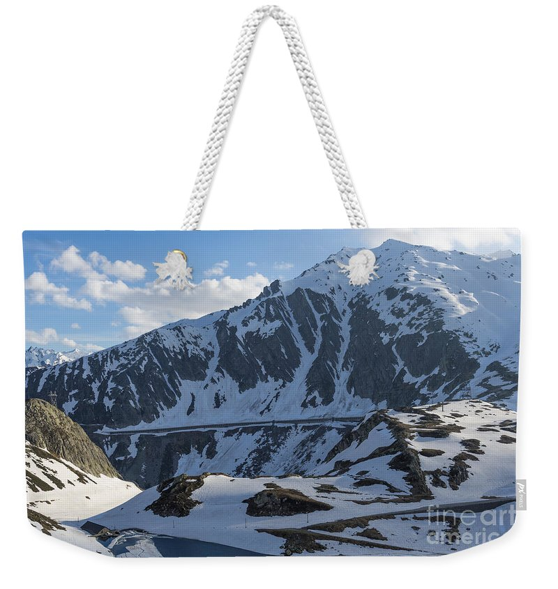 Snow-capped Weekender Tote Bag featuring the photograph Swiss Alps by Mats Silvan