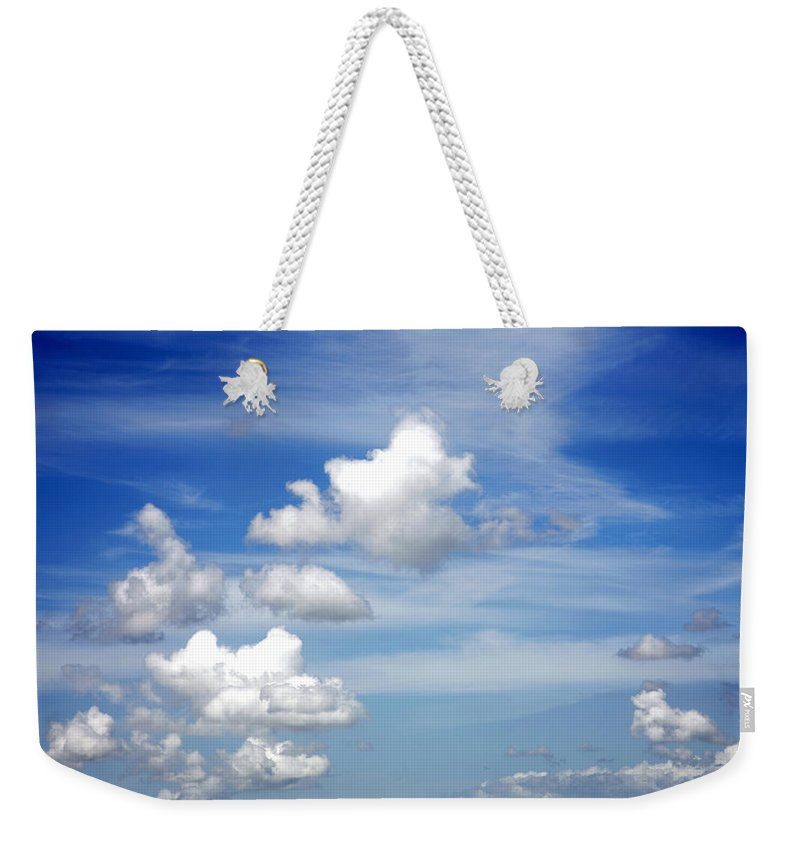 Sky Weekender Tote Bag featuring the photograph Clouds by Les Cunliffe