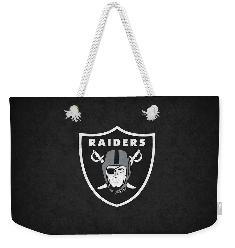 Raiders Weekender Tote Bag featuring the photograph Oakland Raiders by Joe Hamilton