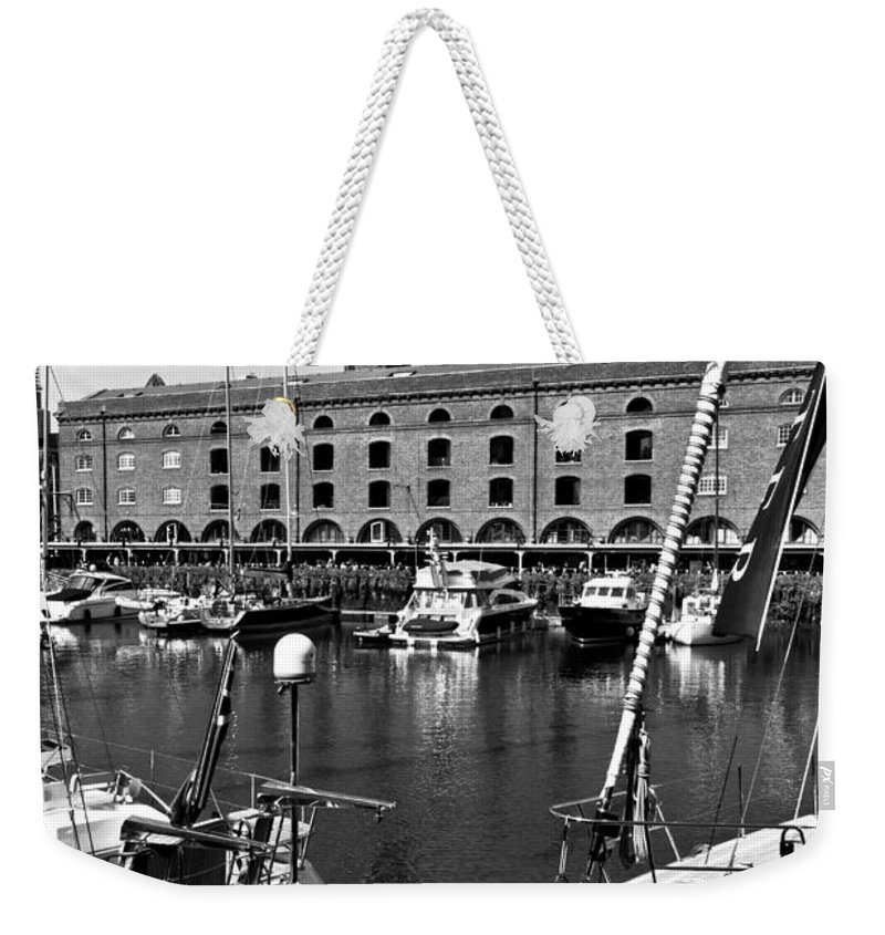 River Thames Weekender Tote Bag featuring the photograph St Katherines Dock London by David Pyatt