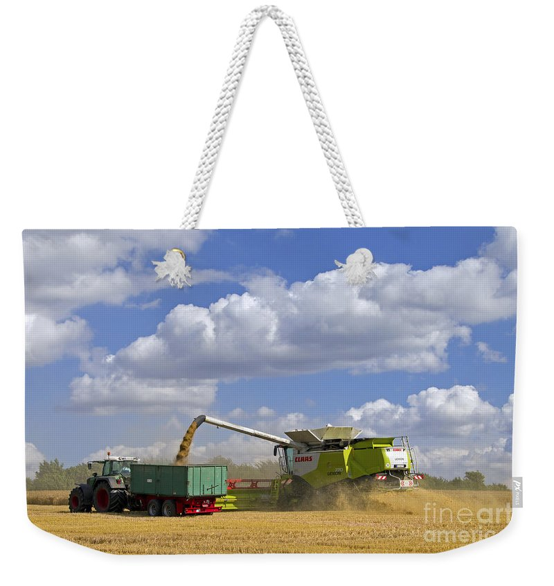 Combine Harvester Weekender Tote Bag featuring the photograph 130201p025 by Arterra Picture Library