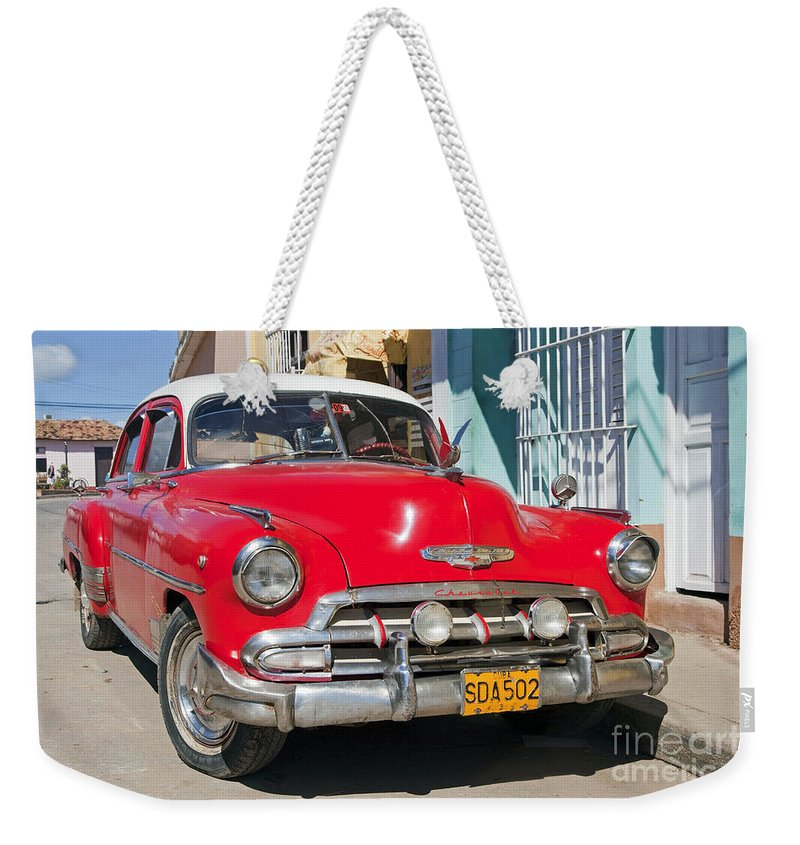 Red Weekender Tote Bag featuring the photograph 130215p067 by Arterra Picture Library