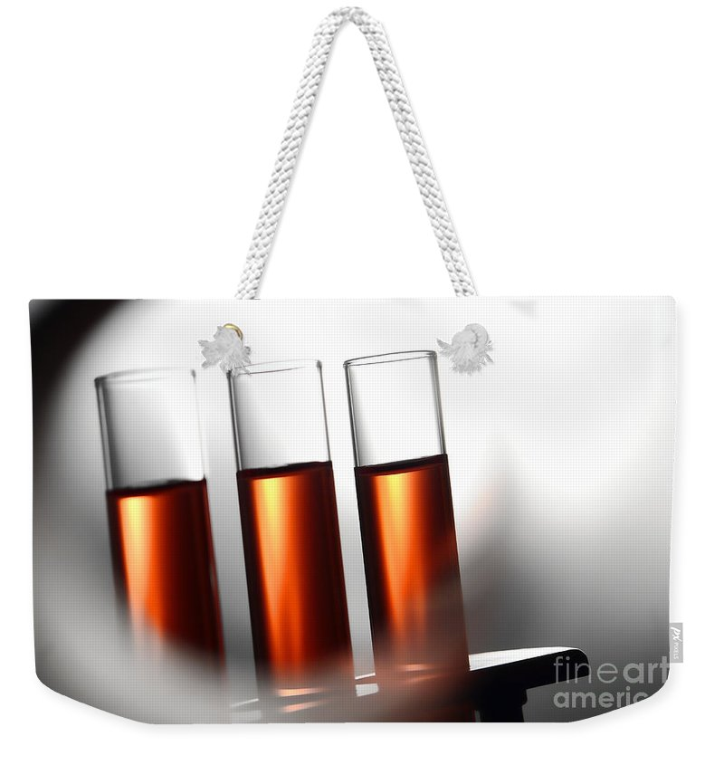 Test Weekender Tote Bag featuring the photograph Laboratory Test Tubes In Science Research Lab by Science Research Lab By Olivier Le Queinec