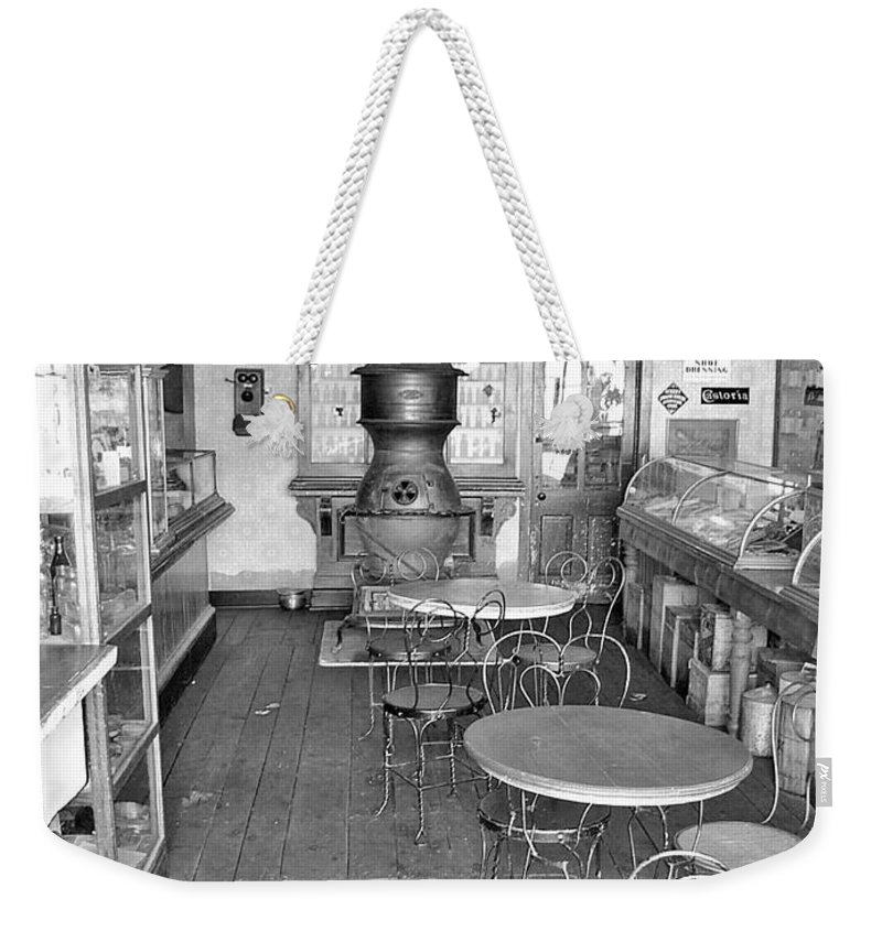 Vintage Drug Store Pictures Weekender Tote Bag featuring the photograph 1880 Drug Store Black And White by Ken Smith