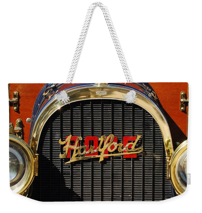 1910 Pope Hartford Model T Grille Emblem Weekender Tote Bag featuring the photograph 1910 Pope Hartford Model T Grille Emblem by Jill Reger