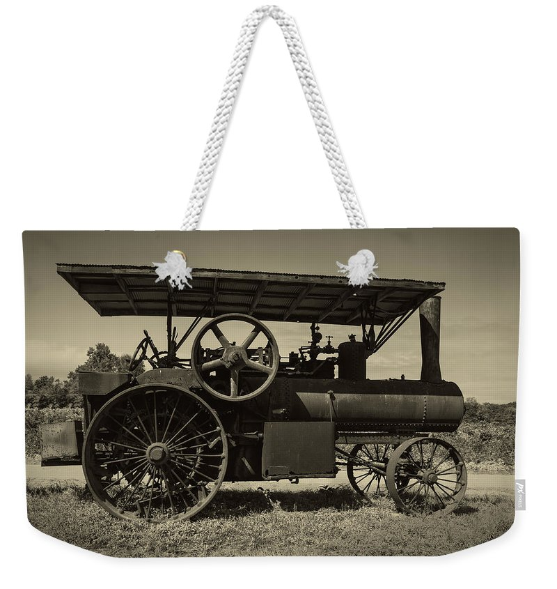 1921 Weekender Tote Bag featuring the photograph 1921 Aultman Taylor Tractor by Debra and Dave Vanderlaan