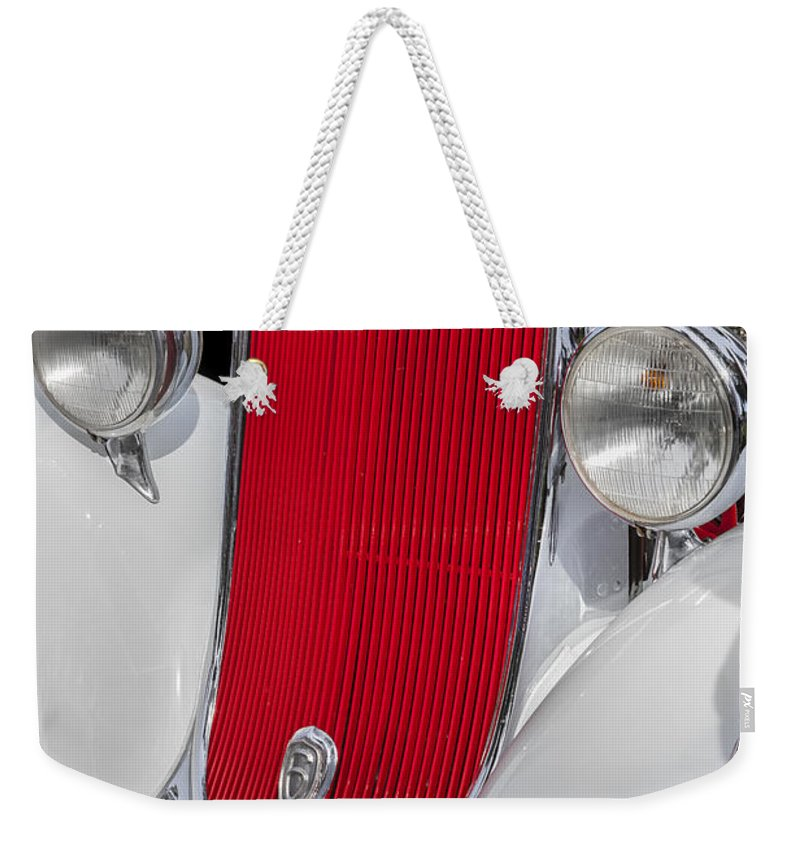 Dodge Weekender Tote Bag featuring the photograph 1933 Dodge Sedan by Rich Franco