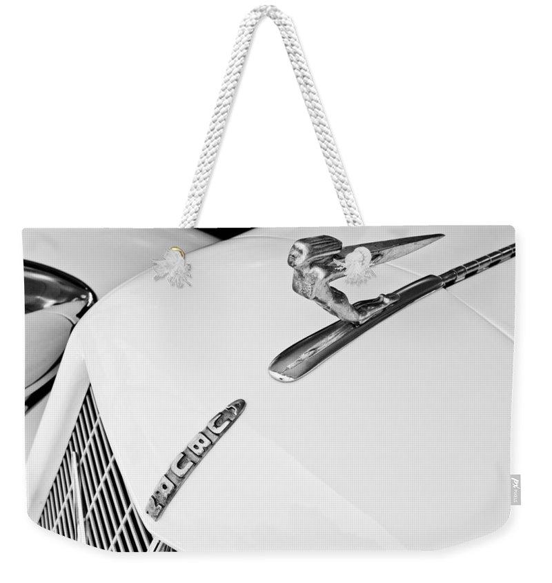 1935 Auburn Boat Tail Speedster Weekender Tote Bag featuring the photograph 1935 Auburn Boattail Speedster Hood Ornament by Jill Reger