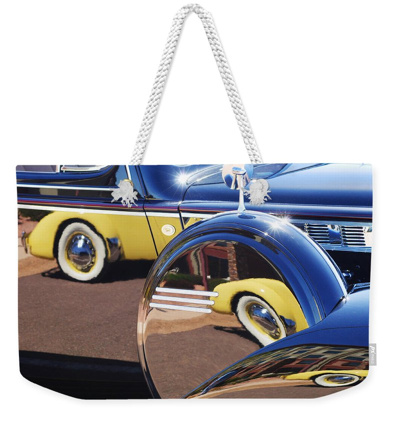 1937 Cord 812 Phaeton Reflected Into Packard Weekender Tote Bag featuring the photograph 1937 Cord 812 Phaeton Reflected Into Packard by Jill Reger