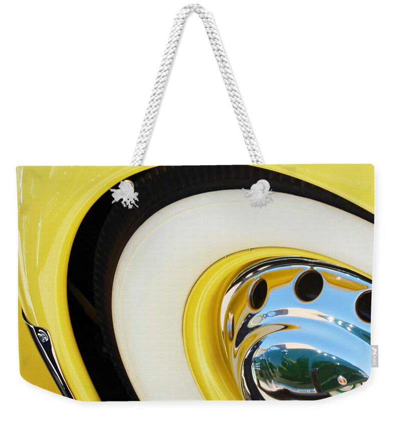 1937 Cord 812 Phaeton Wheel Rim Reflecting Cadillac Weekender Tote Bag featuring the photograph 1937 Cord 812 Phaeton Wheel Rim Reflecting Cadillac by Jill Reger