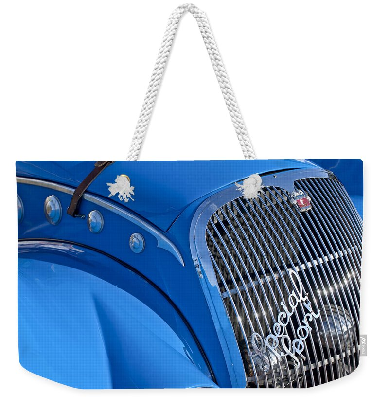 1937 Peugeot 402 Darl'mat Legere Special Sport Roadster Recreation Weekender Tote Bag featuring the photograph 1937 Peugeot 402 Darl'mat Legere Special Sport Roadster Recreation Grille Emblem by Jill Reger