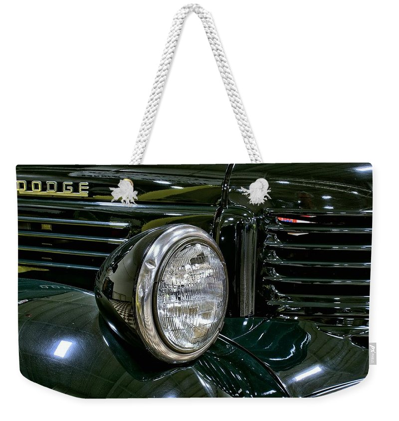1940 Weekender Tote Bag featuring the photograph 1940 Dodge Pickup Headlight Grill by Michael Gordon