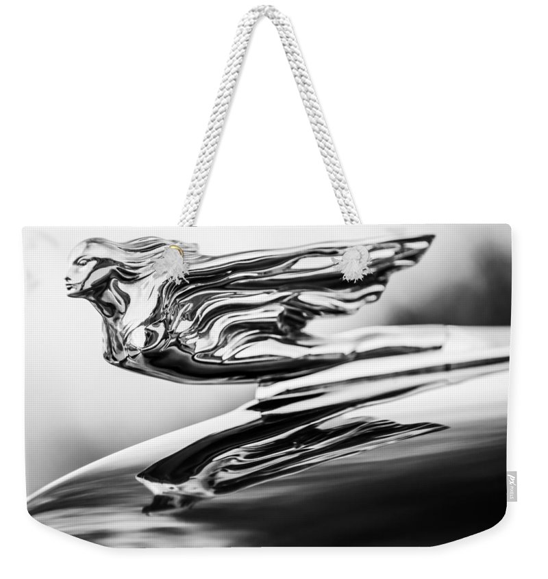 1941 Cadillac Weekender Tote Bag featuring the photograph 1941 Cadillac Hood Ornament 4 by Jill Reger