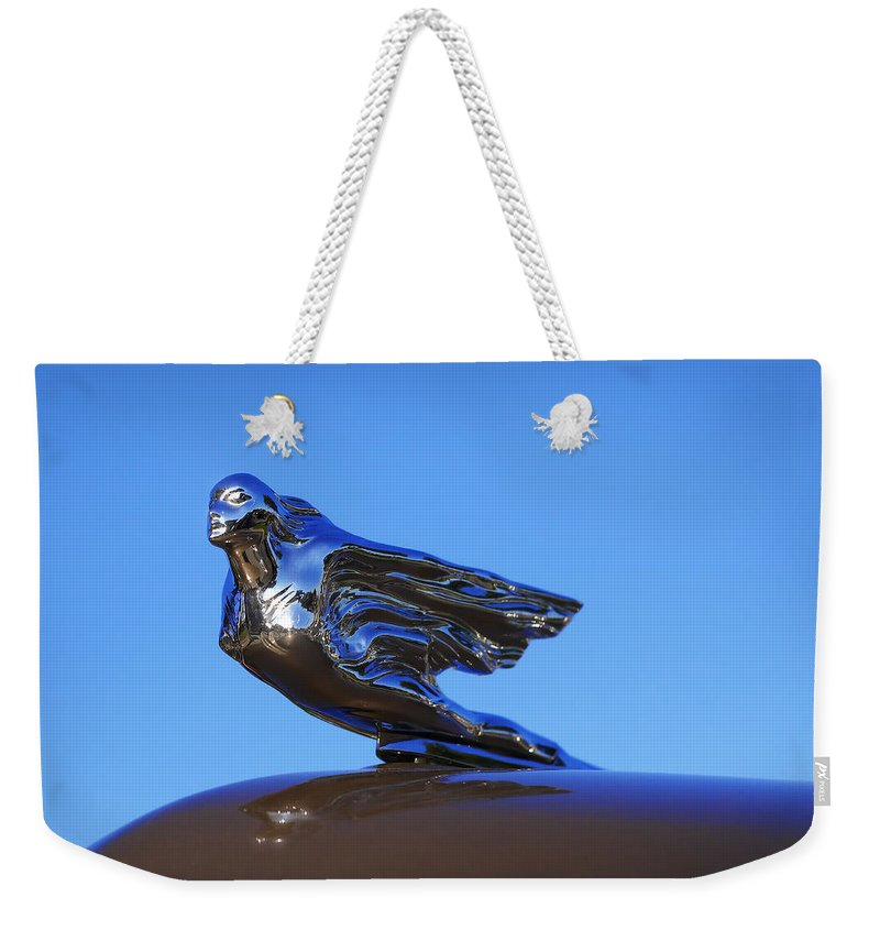 Weekender Tote Bag featuring the photograph 1941 Cadillac Series 62 Coupe Hood Ornament by Gordon Dean II