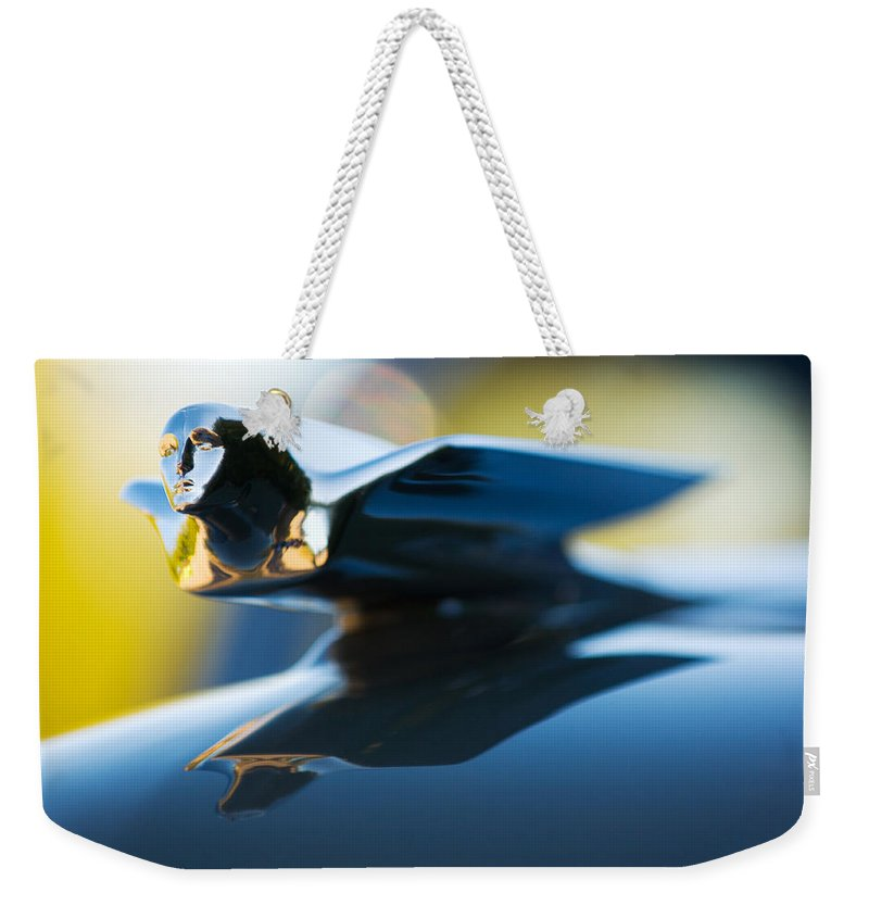 1947 Cadillac Model 62 Coupe Hood Ornament Weekender Tote Bag featuring the photograph 1947 Cadillac Model 62 Coupe Hood Ornament by Jill Reger