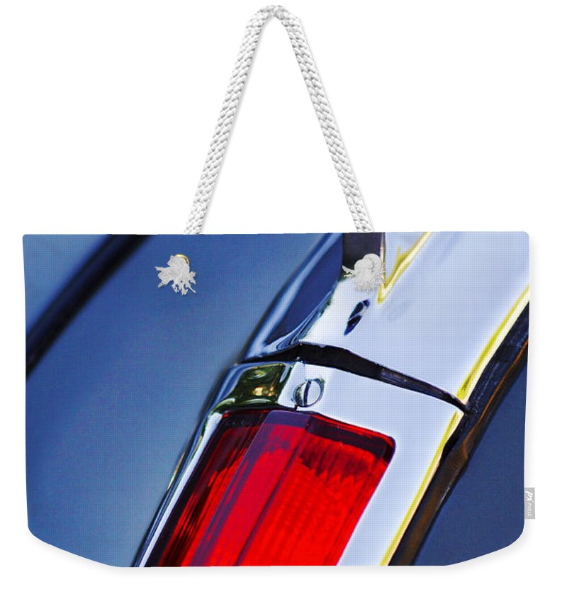 1947 Cadillac Model 62 Coupe Taillight Weekender Tote Bag featuring the photograph 1947 Cadillac Model 62 Coupe Taillight by Jill Reger