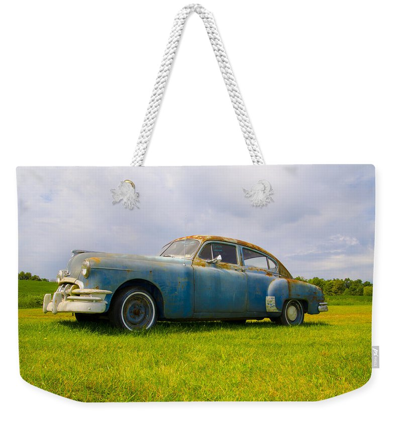 1950 Weekender Tote Bag featuring the photograph 1950 Pontiac Chieftan by Bill Cannon